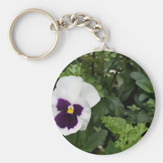 white purple pansy flower against green keychains