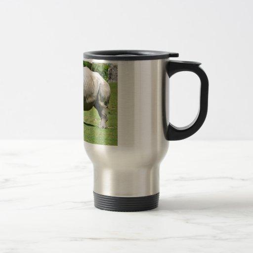 White rhinoceros grazing grass coffee mug
