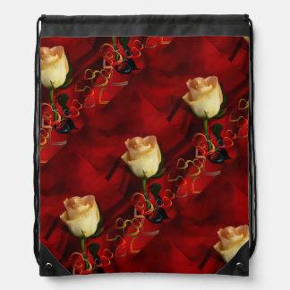 White rose on red background drawstring bag