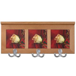 White rose on red background coat racks