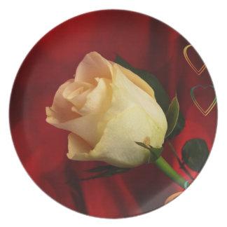 White rose on red background dinner plates