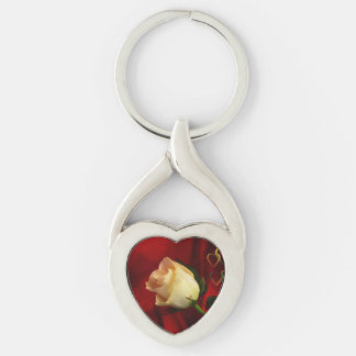 White rose on red background key chains