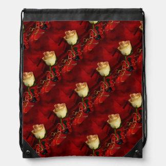 White rose on red background drawstring backpack