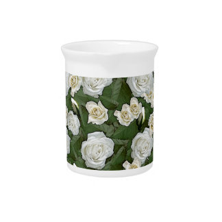 White roses and green leaves pitcher