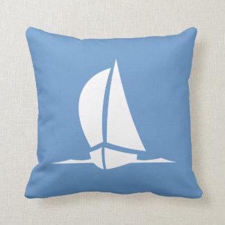 white sailboat on blue pillow