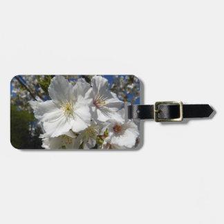 white sakura luggage tag