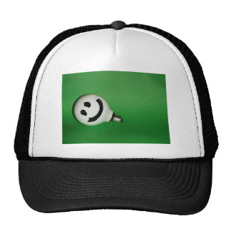 White smiling bulb on green background hats