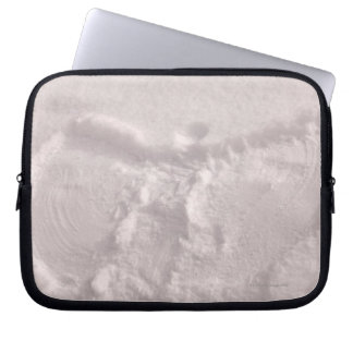 White snow imprinted with a snow angel laptop sleeve