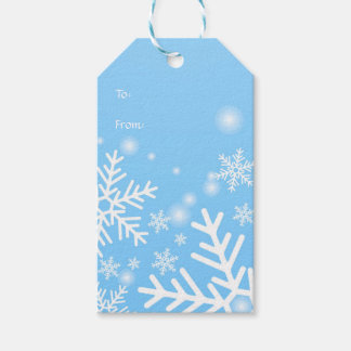 White snowflakes on blue Christmas Gift Tags