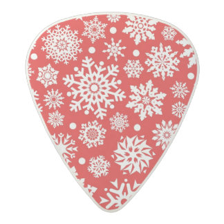 White snowflakes on red acetal guitar pick