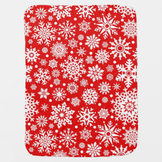 White snowflakes on red baby blanket