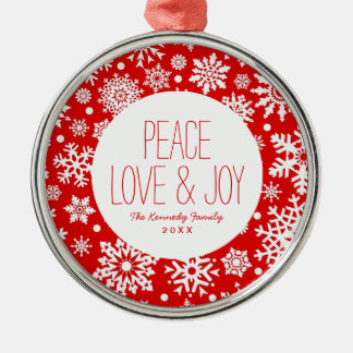 White snowflakes on red christmas ornament