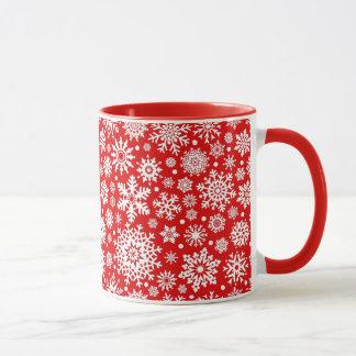 White snowflakes on red mug