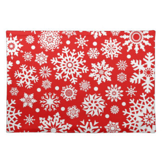 White snowflakes on red placemat