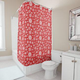 White snowflakes on red shower curtain