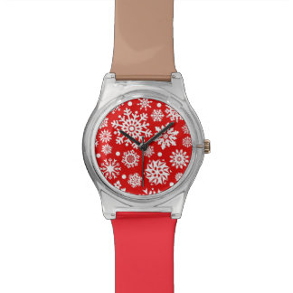 White snowflakes on red wristwatch