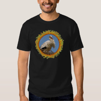 White stork in its nest in frame of leaves t shirts