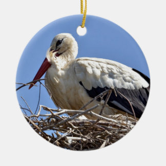 White stork in its nest round ceramic decoration