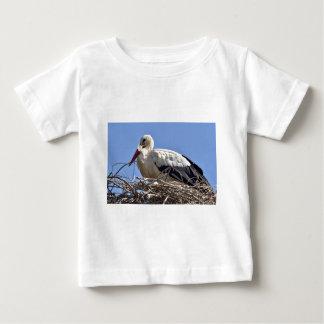 White stork in its nest shirt