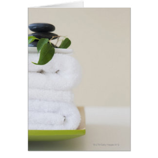White towels and spa stones card