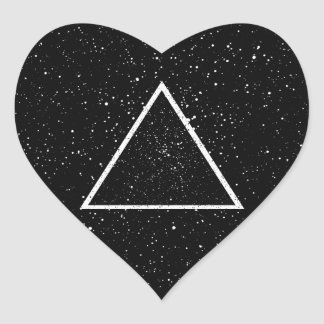 White triangle outline on black star background heart sticker