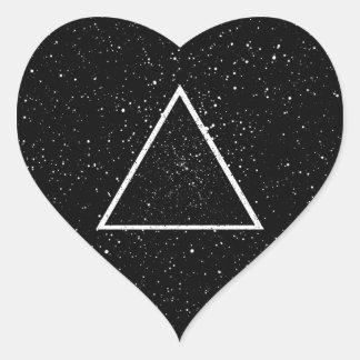 White triangle outline on black star background heart sticker