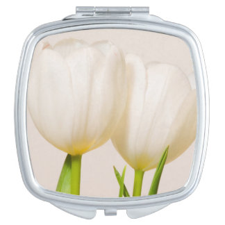 White tulips against a white background, travel mirror