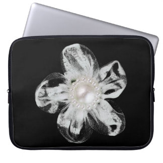 White tulle flower on black computer sleeve