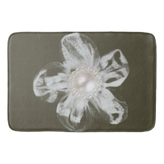 White tulle flower on dark gray bath mats