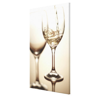 White Wine Being Poured Into Glass Canvas Print
