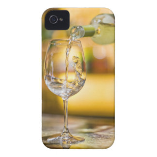 White wine is poured from bottle in restaurant. iPhone 4 cases