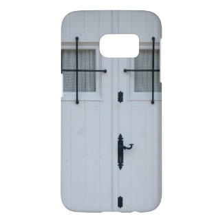 White Wooden Door With Black Wrought Iron Bars