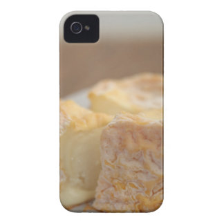 Whole of cheese on table iPhone 4 cover