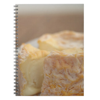 Whole of cheese on table notebook