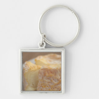 Whole of cheese on table Silver-Colored square key ring