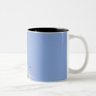 Whooper Swans flying in the sky Two-Tone Coffee Mug