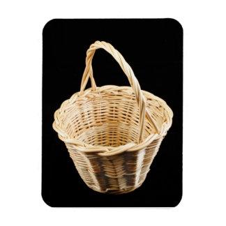 Wicker basket on black background rectangular photo magnet