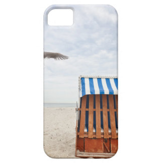 Wicker beach chair on beach iPhone 5 cases