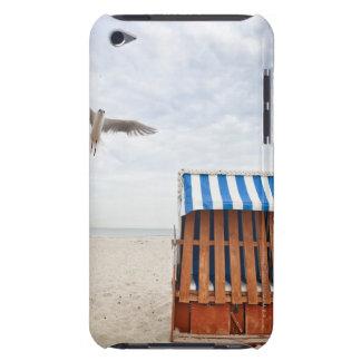 Wicker beach chair on beach iPod Case-Mate cases