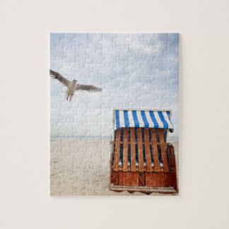 Wicker beach chair on beach jigsaw puzzle