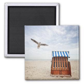 Wicker beach chair on beach magnet