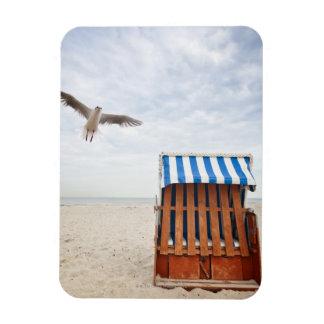 Wicker beach chair on beach rectangular photo magnet