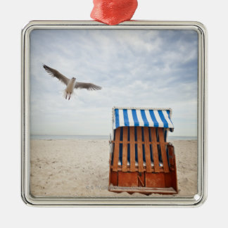 Wicker beach chair on beach Silver-Colored square decoration
