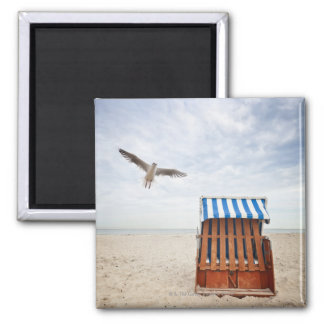 Wicker beach chair on beach square magnet