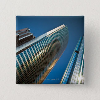 Wide-angle shot looking up at gleaming glass 15 cm square badge