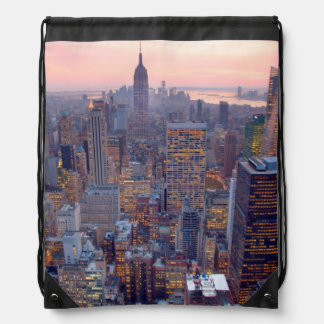 Wide view of Manhattan at sunset Backpack