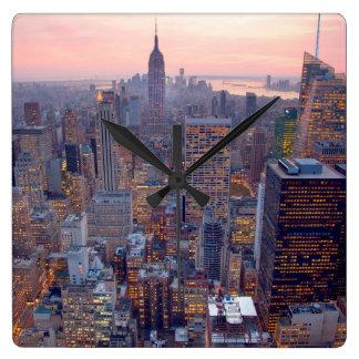 Wide view of Manhattan at sunset Clock