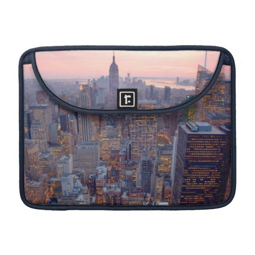 Wide view of Manhattan at sunset MacBook Pro Sleeves