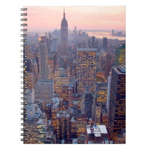 Wide view of Manhattan at sunset Spiral Notebook