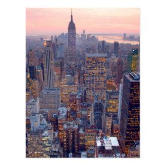Wide view of Manhattan at sunset Postcard